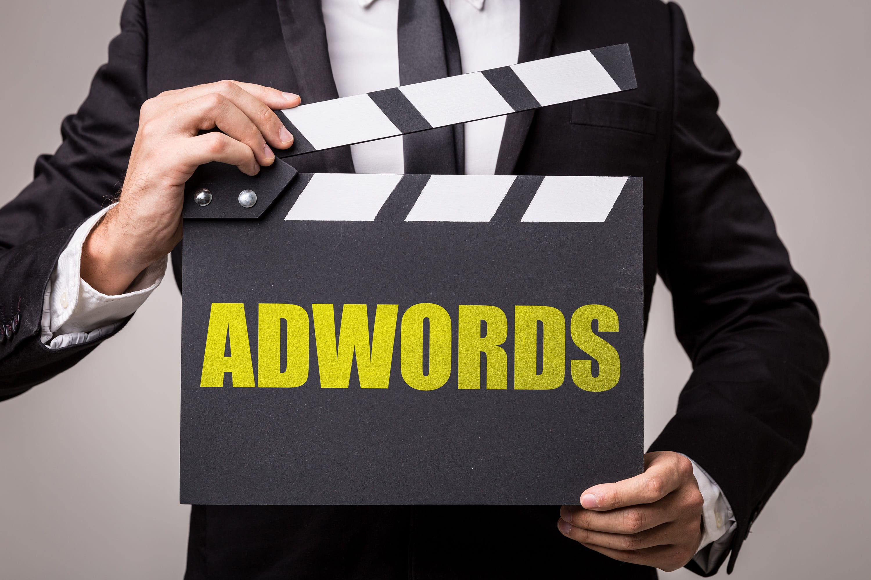 man holding adwords film sign why you should never let google set up your adwords account